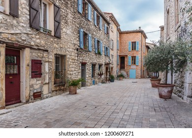 Tourrettes, France - 30 OCTOBER, 2014: Narrow street with flowers in the old village Tourrettes-sur-Loup , France.