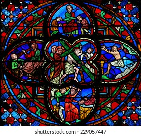 TOURS, FRANCE - AUGUST 14, 2014: Stained glass window dating from the 13th Century in the Cathedral of Tours, France. This window depicts Jesus on the Via Dolorosa in the center.