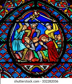 TOURS, FRANCE - AUGUST 14, 2014:  Stained glass window depicting Martyrs in the Saint Gatien Cathedral of Tours, France.