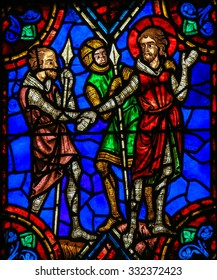 TOURS, FRANCE - AUGUST 14, 2014: Stained glass window depicting Medieval Knights in the Saint Gatien Cathedral of Tours, France.