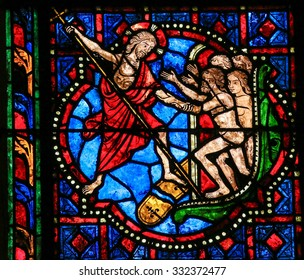 TOURS, FRANCE - AUGUST 14, 2014: Stained glass window depicting Jesus Christ saving mankind in the Cathedral of Tours, France.