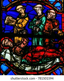 Tours, France - August 14, 2014: Stained Glass (1300) in the Cathedral of Tours, France, depicting Saint Martin dying in Candes