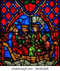 Tours, France - August 14, 2014: 13th Century Stained Glass in the Cathedral of Tours, France, depicting Joseph, Jesus and Mary departing by Sea, symbol of their passage into a new world.