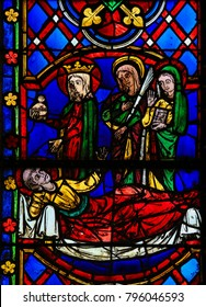 Tours, France - August 14, 2014: Stained Glass in the Cathedral of Tours, France, depicting St Martin and the Saints Mary, Agnes and Tekla