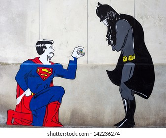 TOURS, FRANCE - JUNE 12 2013 : Street art shows Superman proposing to Batman, on June 12, 2013 in Tours, France. New art trend appears in France where gay marriage is legal since May 18, 2013.