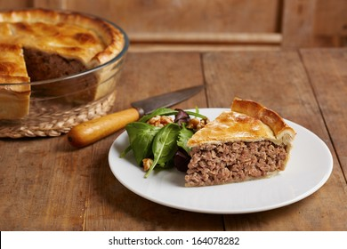 Tourtiere Canadian traditional meat pie on a dish
