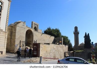Toutists exploring the Palace of the Shirvanshahs in Ichery Sheher (Walled City of Baku), Baku, Azerbaijan, on October 8th, 2017