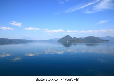 Touyako Lake, the Youteizan Mountain (The Ezo Fuji Mountain) and the middle islands in the lake under a blue sunny sky. Photoed in Hokkaido, Japan.