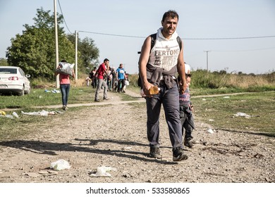 TOVARNIK, CROATIA - SEPTEMBER 18: Refugees cross the uncontrolled border from Serbia to Croatia on September 18, 2015 in Tovarnik, Croatia.
