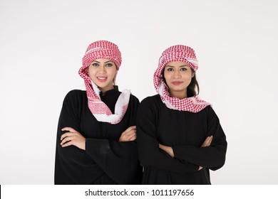 Tow Arabic Women in traditional dress on white background