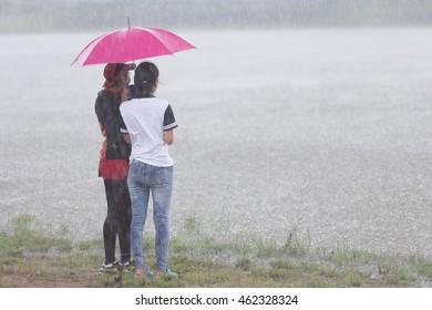 Tow asia girl under Rain