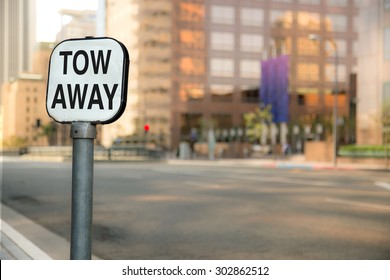 Tow away sign bokeh blurred blurry background urban city business district buildings downtown