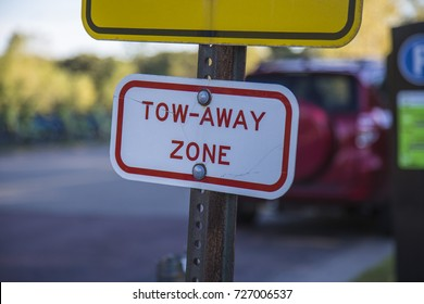Tow away zone parking sign red white