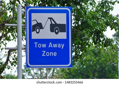 tow away zone traffic sign board