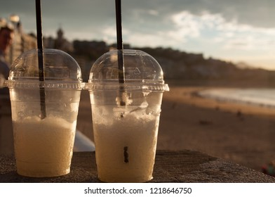 Tow cups of lemon granita (slush) in the beach promenade of La Concha beach in San Sebastian, Guipuzcoa, Vasque Country