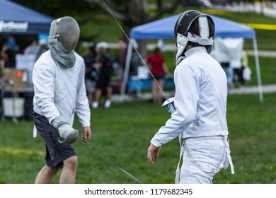 Tow fencing athletes