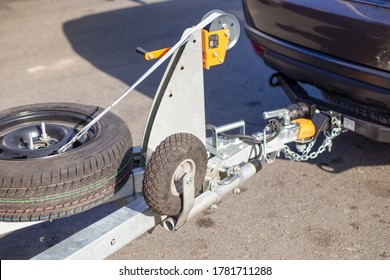 tow hitch for towing a trailer by a passenger car, trailer drawbar with a spare wheel