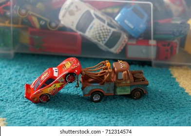 Tow Matter pulling Lighting McQueen with a crane after accident from the Mattel toy car collection of Disney's Cars movie on September 2017 in Poznan, Poland