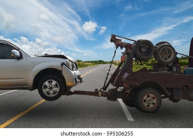 Tow truck delivers the damaged vehicle, Selective focus