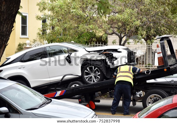 Tow Truck Driver Loading Wrecked Car Stock Photo (Edit Now) 752837998