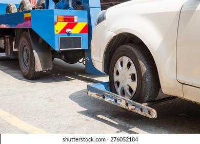 Tow truck towing a broken down car