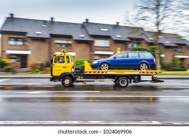 A tow truck transports a defective car