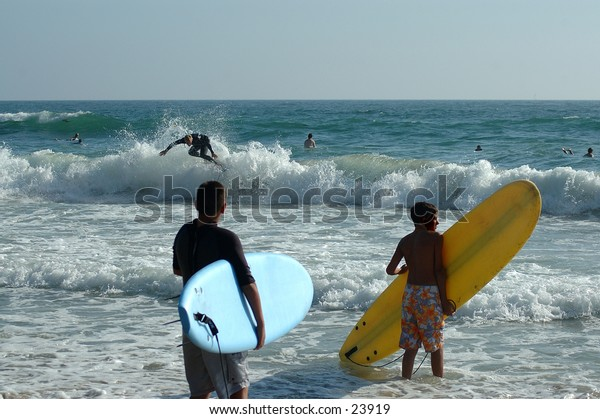 Tow young surfers observing the break