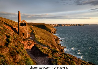 Towanroath Shaft Pumping Engine House ruins at Wheal Coates tine mine Celtic Sea Cornwall England with Great Wheal Charlotte and RAF Portreath St Agnes, Cornwall, England - June 10, 2019