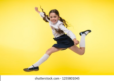 Toward knowledge. Girl make supernatural efforts on way to knowledge. Thirst of knowledge. Back to school. Kid cheerful schoolgirl full of energy jump in mid air. Pupil want study. Lets begin study.