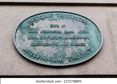 Towcester, Northamptonshire / UK - December 31, 2018: Historic Towcester Millennium Project plaque on wall.