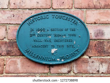 Towcester, Northamptonshire / UK - December 31, 2018: Historic Towcester Millennium Project plaque on brick wall.
