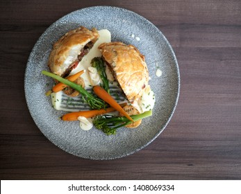 Towcester, UK - April 2019 – Main Course - Vegetable and Cheese Wellington, Gastropub Dining At The Folly In Buckinghamshire