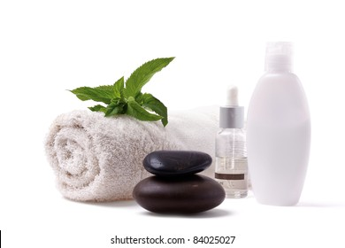 Towel Body Lotions and Black Stones on White Background