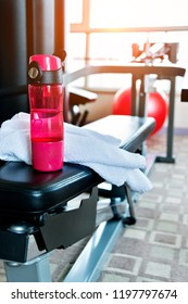 Towel and bottle of water in gym room.
