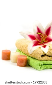 towel, candles and flower isolated on a white background
