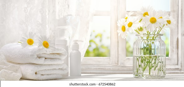 towel with daisy flowers near window