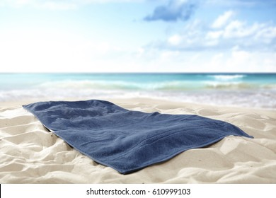 towel on beach of free space for your decoration and summer time