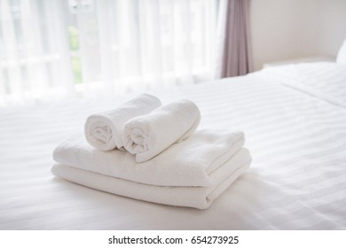 Towel on the bed in the hotel