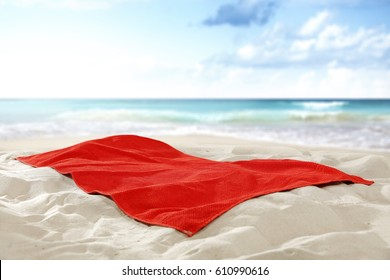 Towel on hot sand of free space for your decoration and landscape of sea