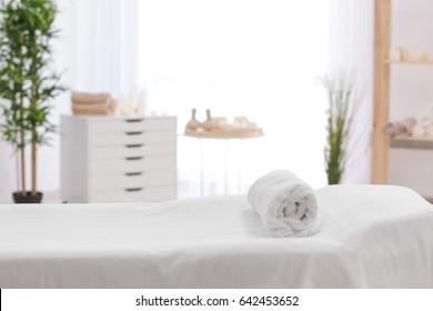 Towel on massage table in modern spa salon