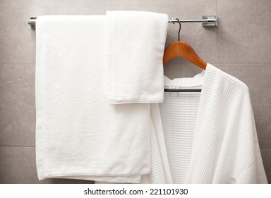 towel and robe on the rack in the bathroom