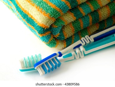 towel and toothbrushes