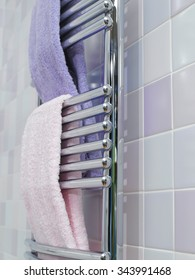 Towel warmer with pink and purple towels