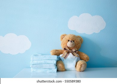 Towels and baby bear in diaper