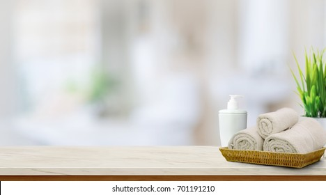Towels in basket on top wood table with copy space on blurred bathroom background.  Copy space for Products Display Concept.