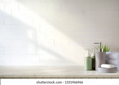Towels and ceramics shampoo or soap on top marble table in bathroom background. - Shutterstock ID 1331966966