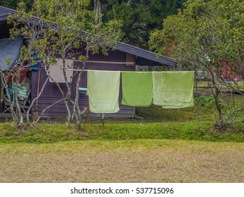 Towels drying on the iron railing on the lawn in camping