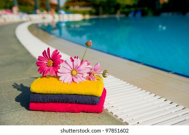 Towels and flowers near the swimming pool