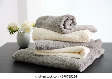 Towels with flowers on table