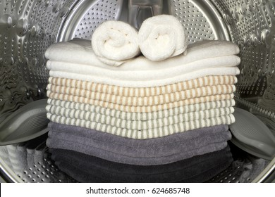towels inside of the washing machine drum